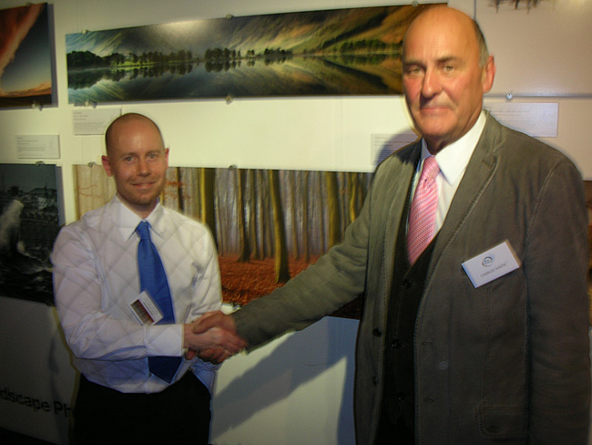 Craig Denford shaking hands with Charlie Waite